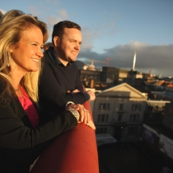 Brenda Willis of Nashville with Liam Brogan Ireland Craft Beers watching the sun rise over the city during the Belfast International Homecoming 2017